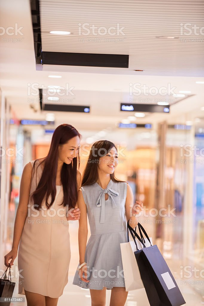 Smiling, Young Asian Women Girlfriends Shopping in Mall, Hong Kong stock photo