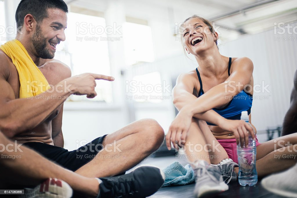 Smiling young athletes refreshing after training stock photo