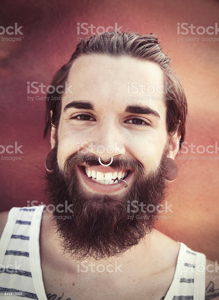Smiling young bearded man portrait stock photo