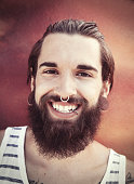 Smiling young bearded man portrait
