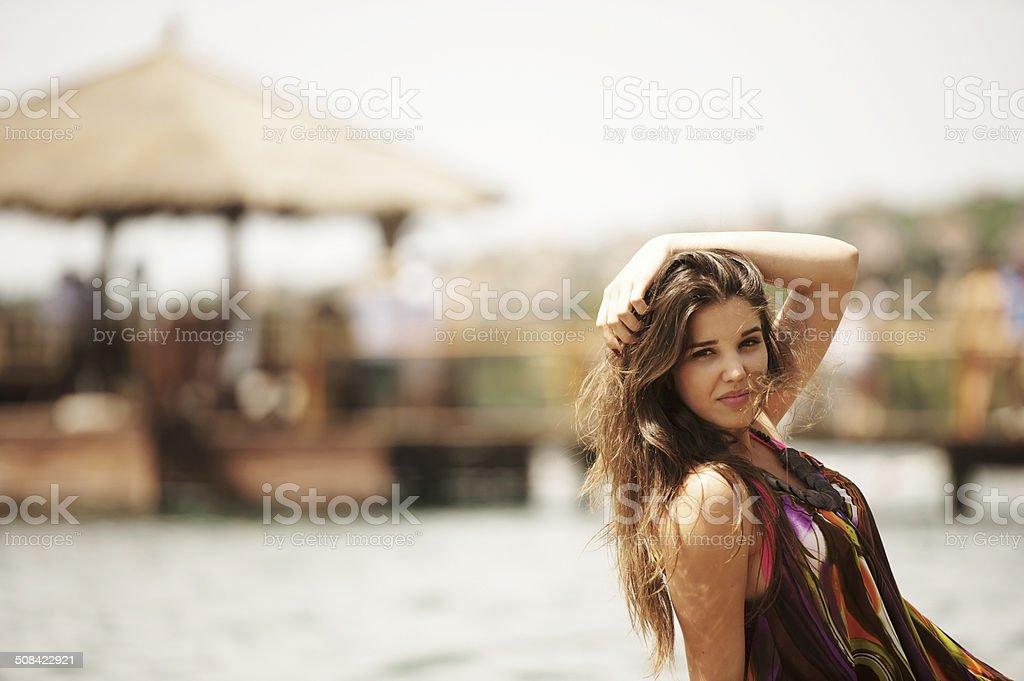 Smiling Young Beautiful Woman Sunbathing on a Beach stock photo