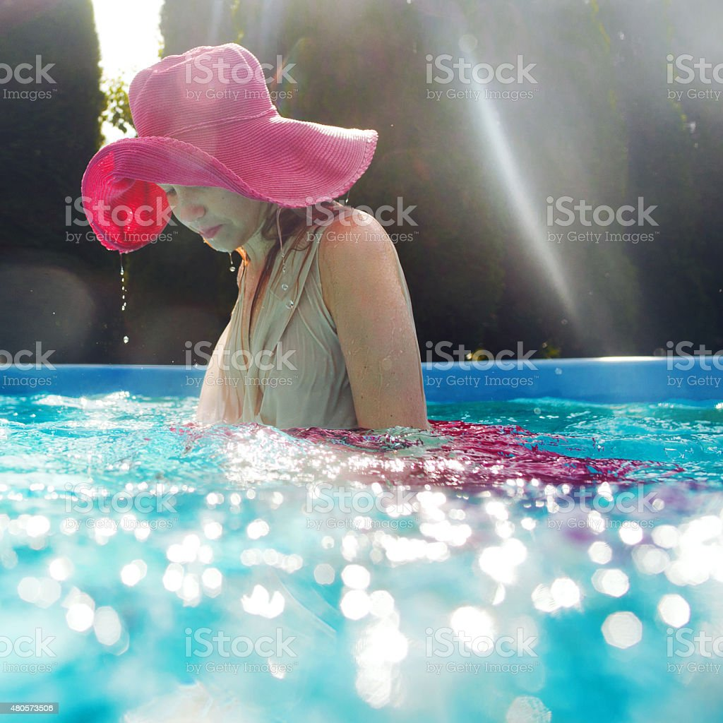 Smiling young beautiful woman underwater stock photo