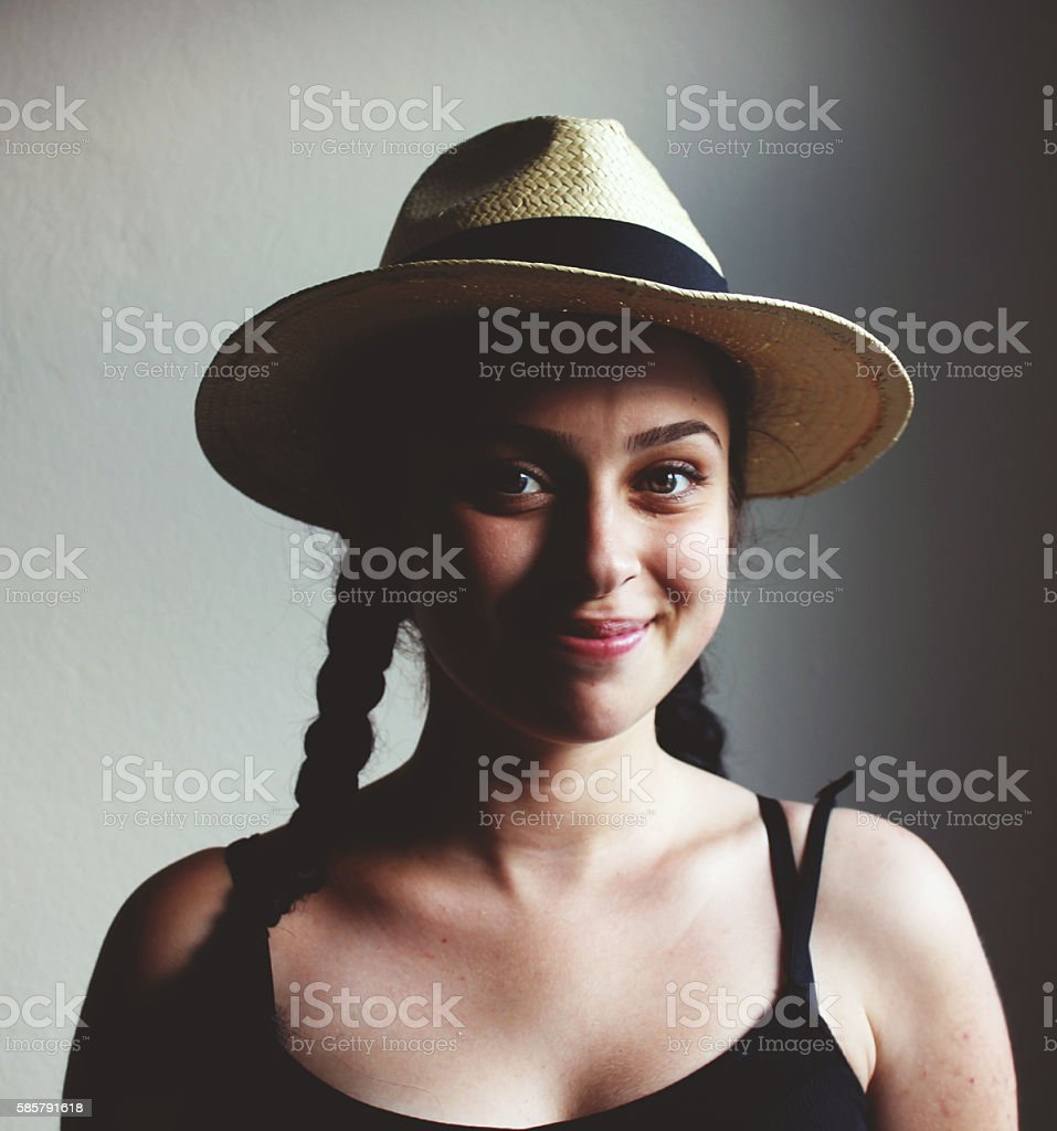 Smiling young beautiful woman with cowboy hat stock photo