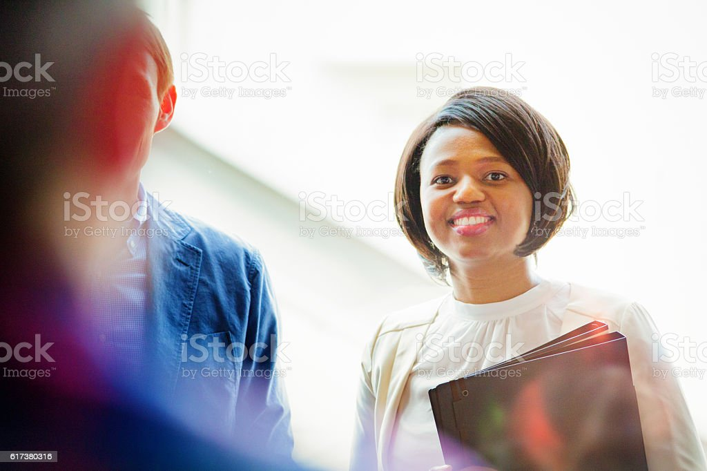 Smiling young black female office worker ready for training stock photo