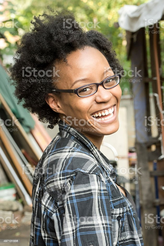 Smiling young black woman stock photo
