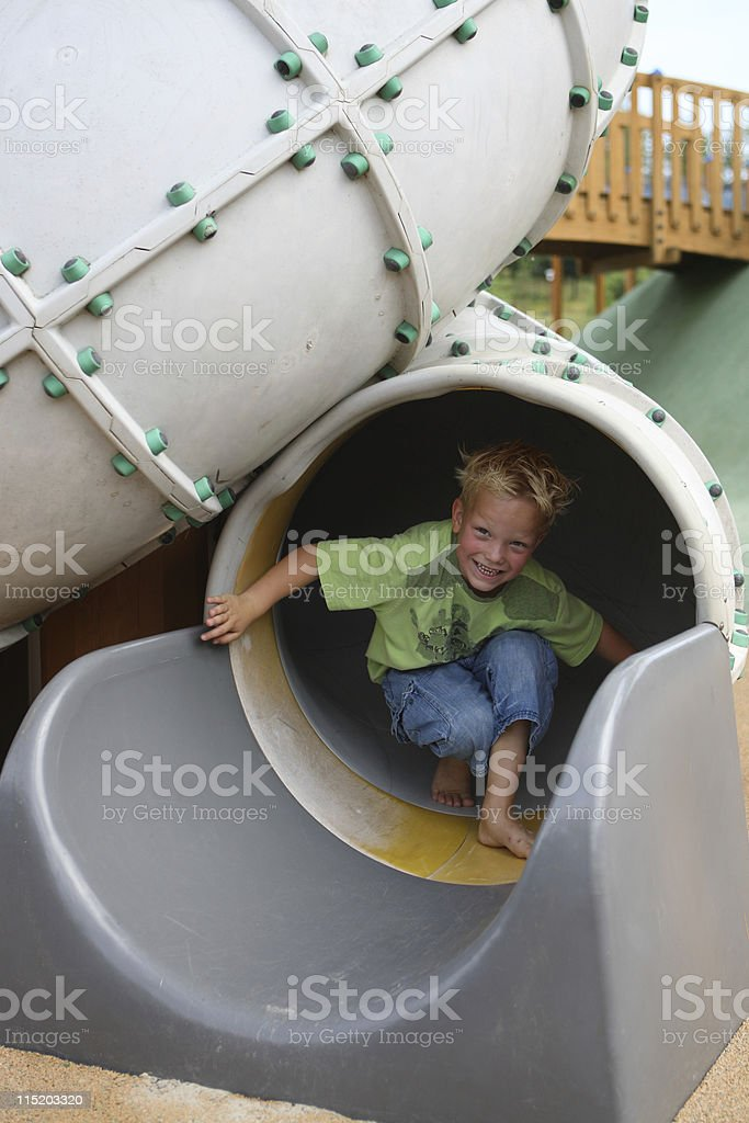 Smiling Young Boy At Playground royalty-free stock photo