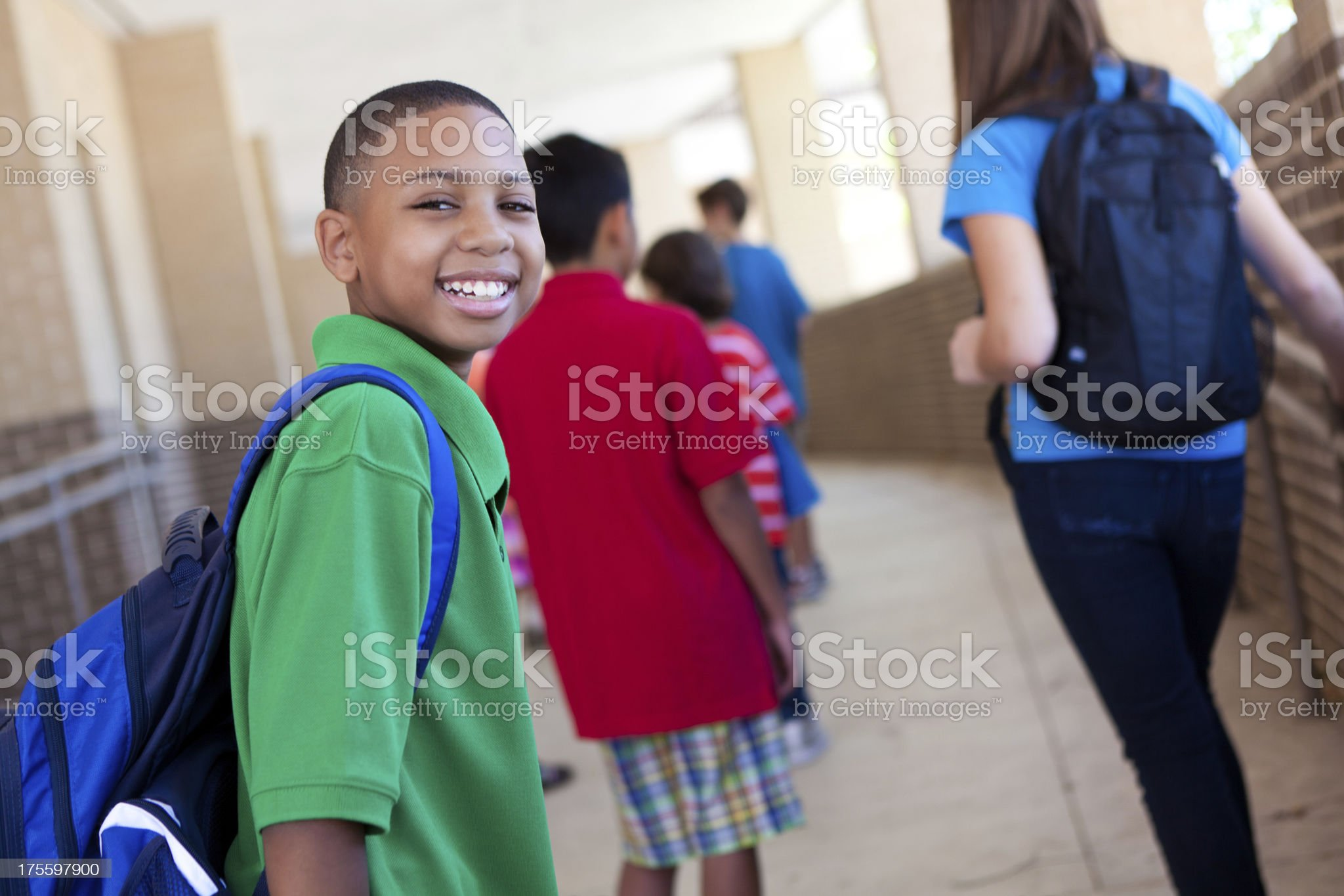 Smiling young boy at school with other students royalty-free stock photo