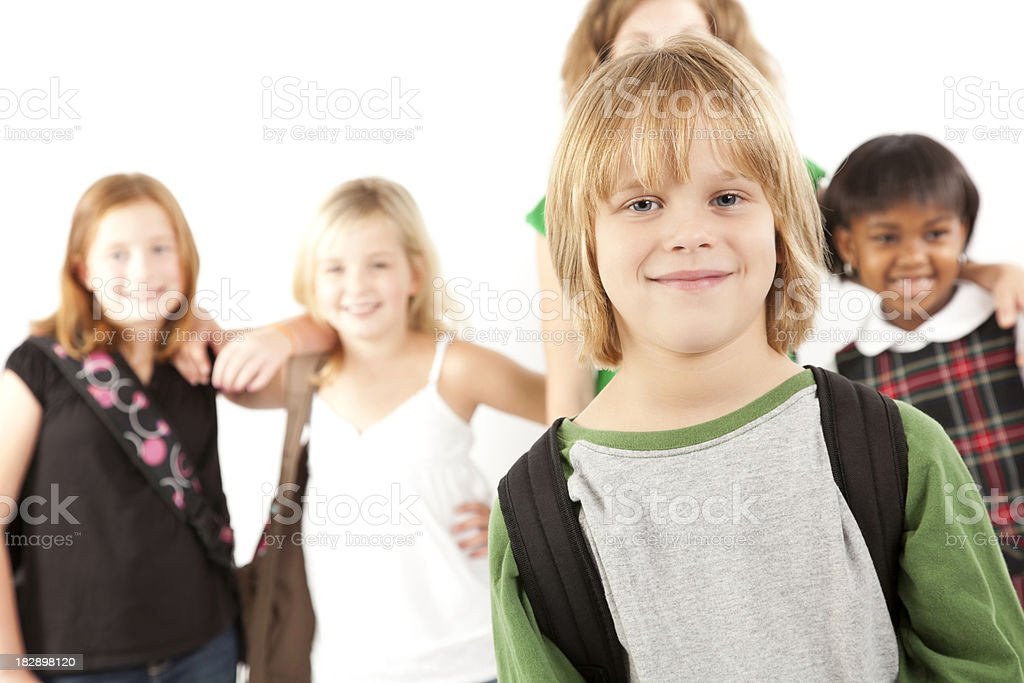 Smiling Young Boy In Front of School Classmates royalty-free stock photo