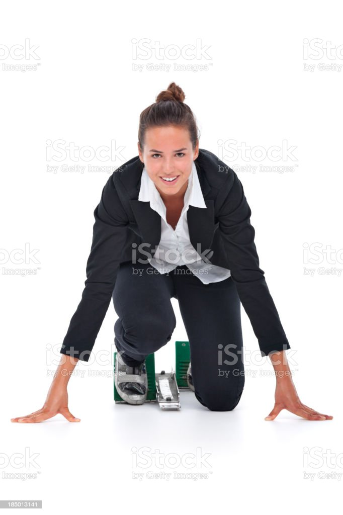 smiling young business woman in starting block royalty-free stock photo