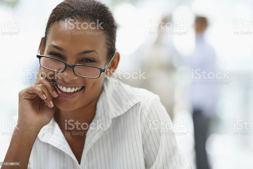 Smiling young business woman wearing spectacles royalty-free stock photo