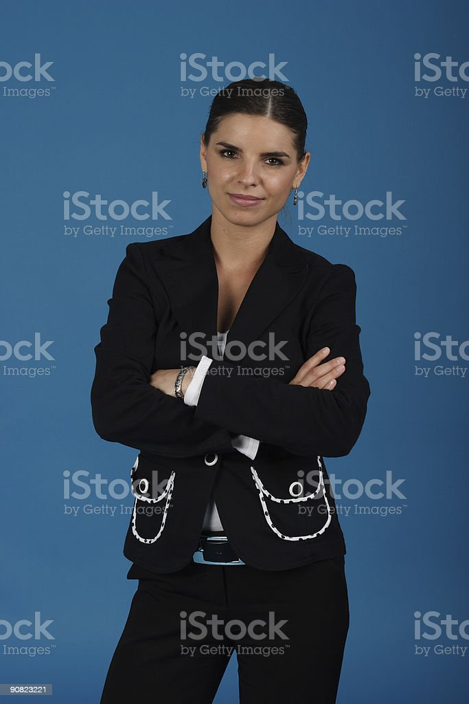 Smiling young business woman with arms crossed royalty-free stock photo
