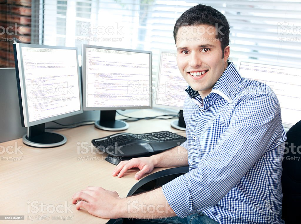 Smiling Young  Businessman at Office stock photo