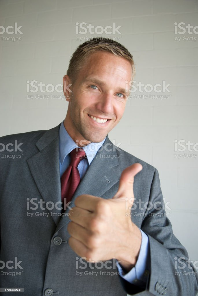 Smiling Young Businessman Giving Thumbs Up royalty-free stock photo