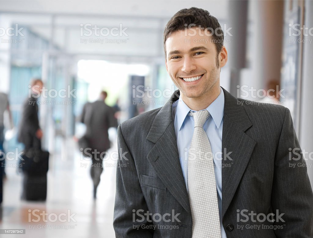 Smiling young businessman in suit and tie stock photo