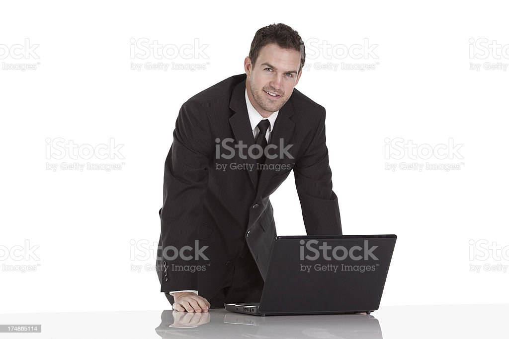 Smiling young businessman with a laptop royalty-free stock photo