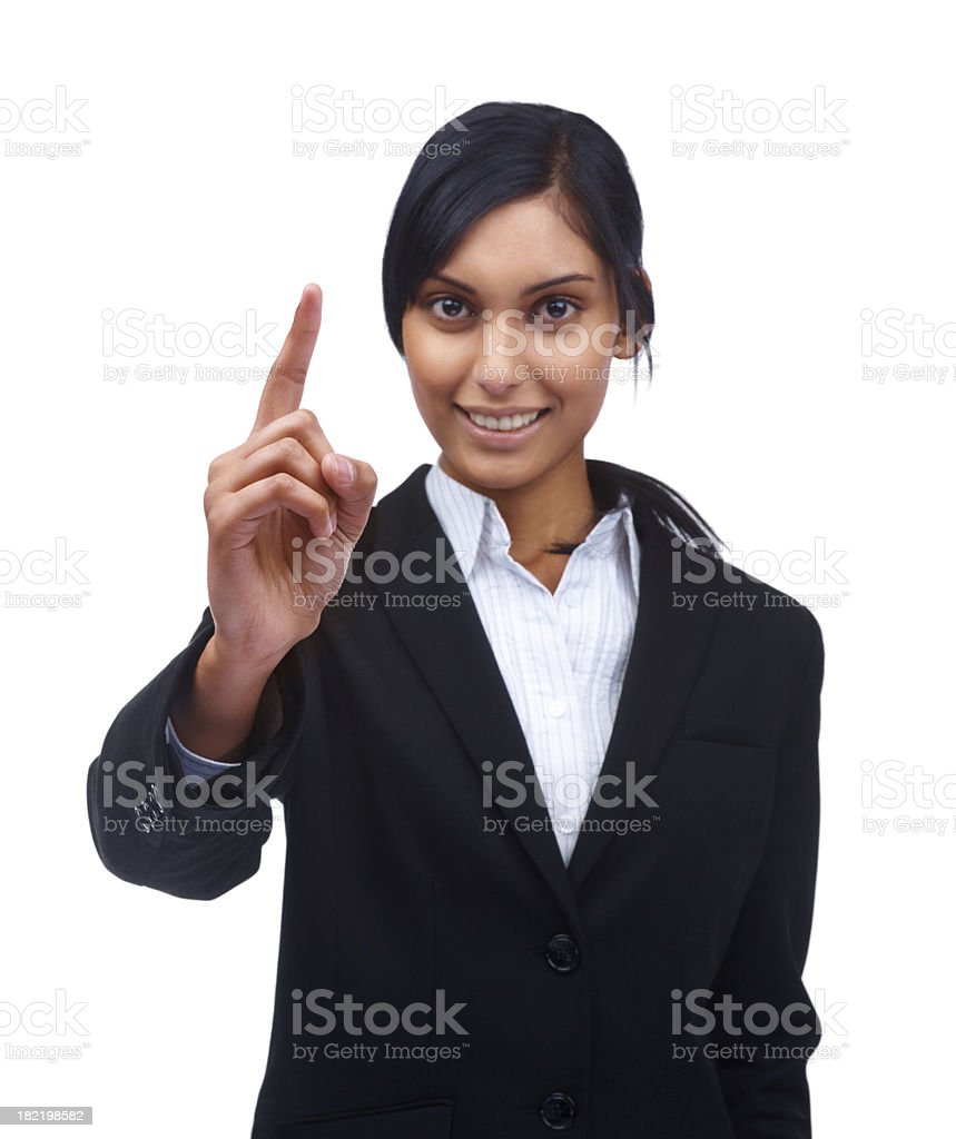 Smiling young businesswoman gesturing over white background royalty-free stock photo