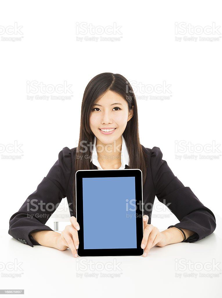 smiling young businesswoman showing tablet pc on the desk royalty-free stock photo