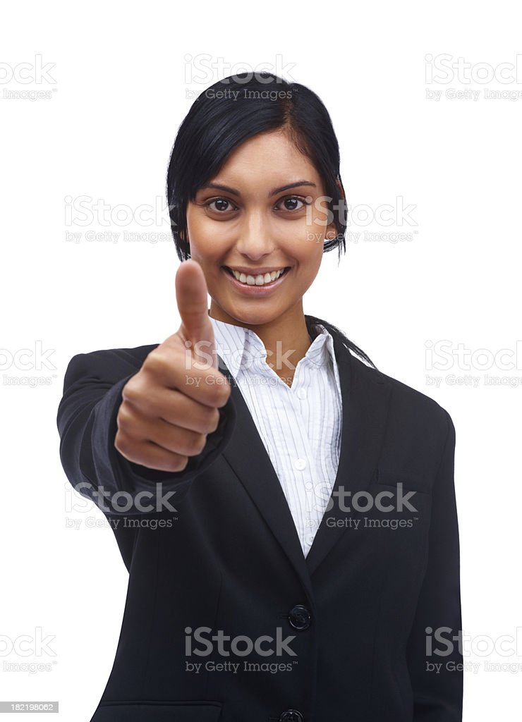 Smiling young businesswoman showing thumbs up sign royalty-free stock photo