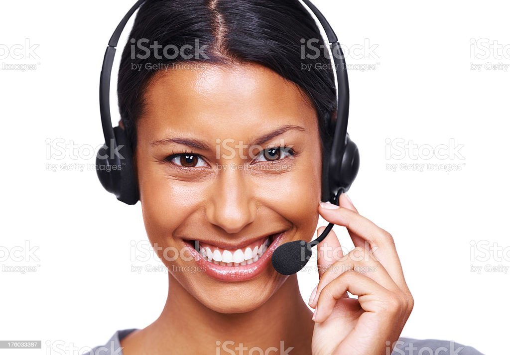 Smiling young call centre executive with a headset over white stock photo