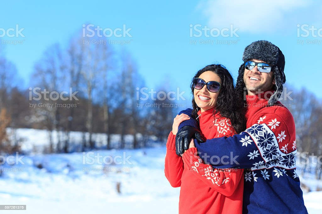 Smiling young couple enjoyng the snow vacations stock photo