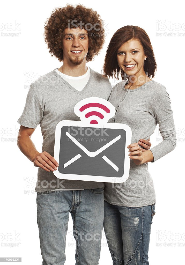 Smiling young couple holding mail sign isolated on white background. royalty-free stock photo