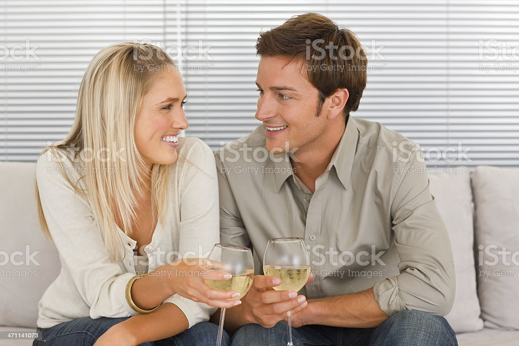 Smiling young couple holding wineglass royalty-free stock photo