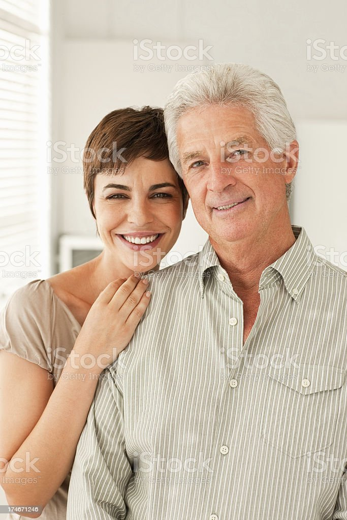 Smiling young daughter standing with her father royalty-free stock photo
