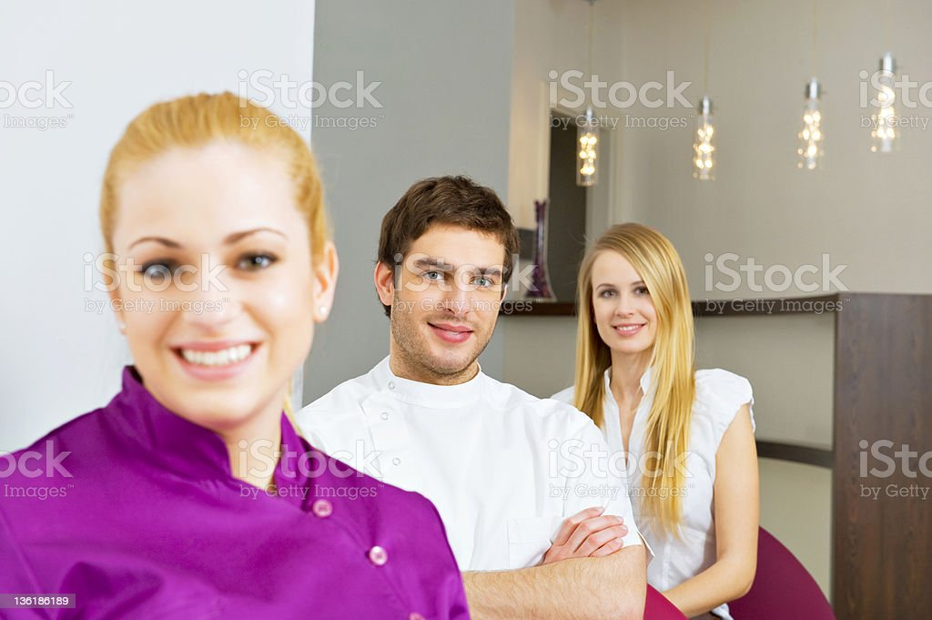 Smiling young doctor with colleagues royalty-free stock photo