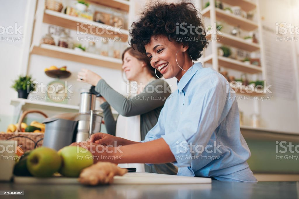 Smiling young employees working at juice bar stock photo