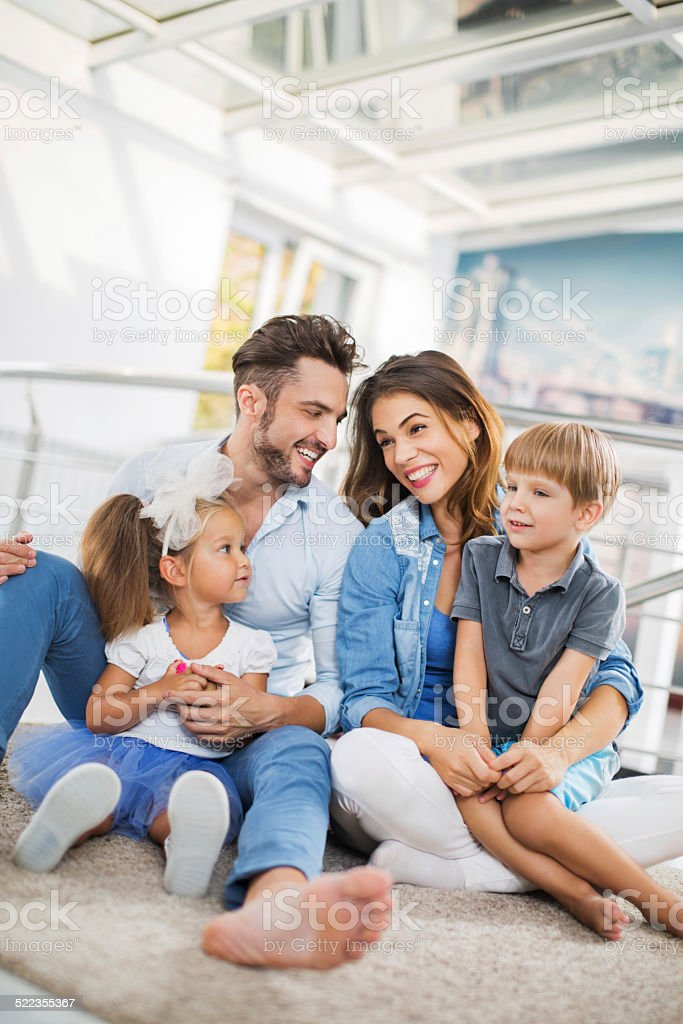 Smiling young family. stock photo