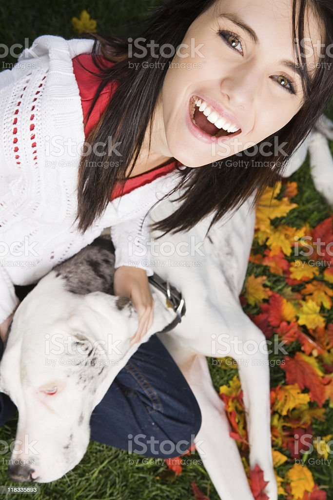 Smiling young female bonding with her dog (great dane) royalty-free stock photo