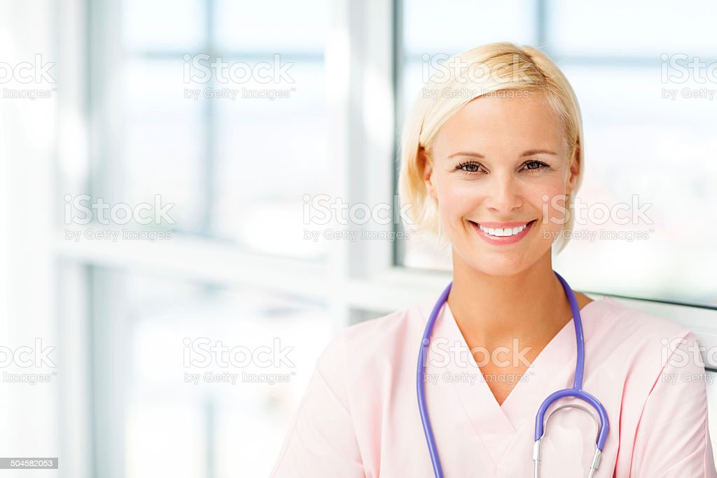 Smiling Young Female Nurse In Hospital stock photo