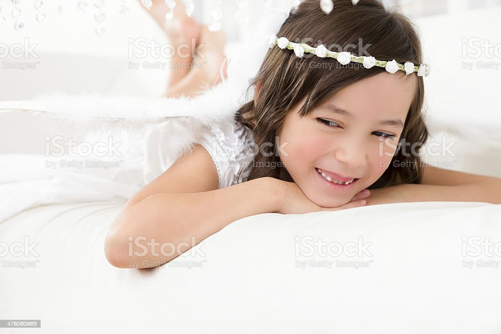 Smiling young girl angel royalty-free stock photo