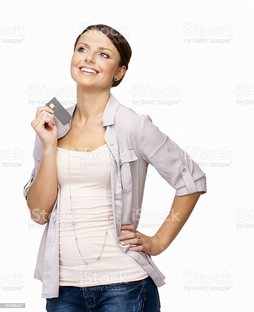 Smiling young girl holding credit card against white background royalty-free stock photo
