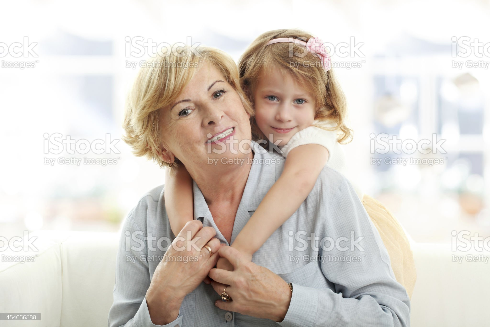 Smiling young girl hugging her grandmother royalty-free stock photo