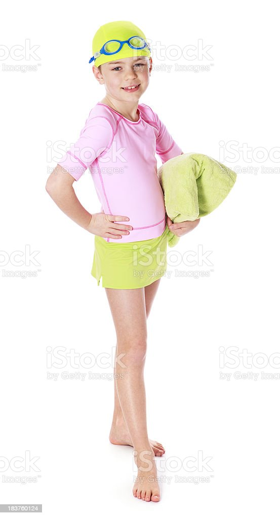 Smiling young girl in bathing suit with beach towel royalty-free stock photo