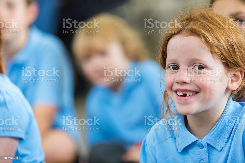 Smiling Young Girl In Class stock photo