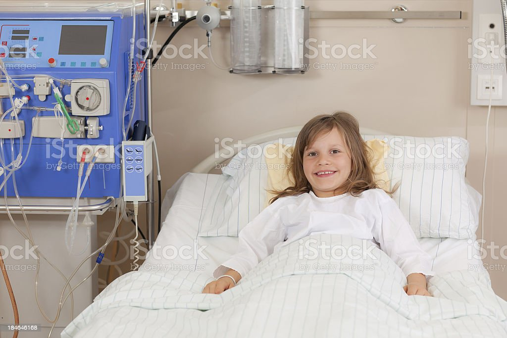 smiling young girl in hospital bed royalty-free stock photo