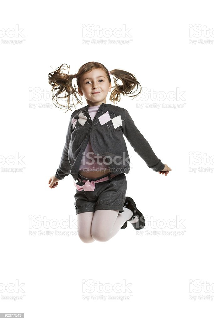 smiling young girl is jumping royalty-free stock photo