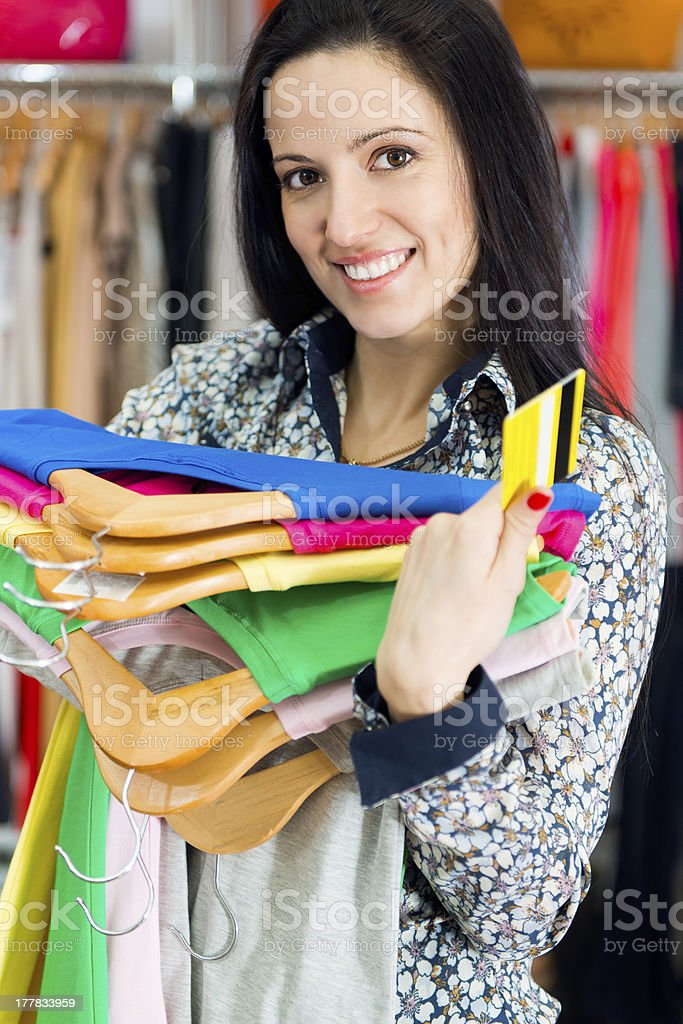 Smiling young girl shopping with credit card royalty-free stock photo