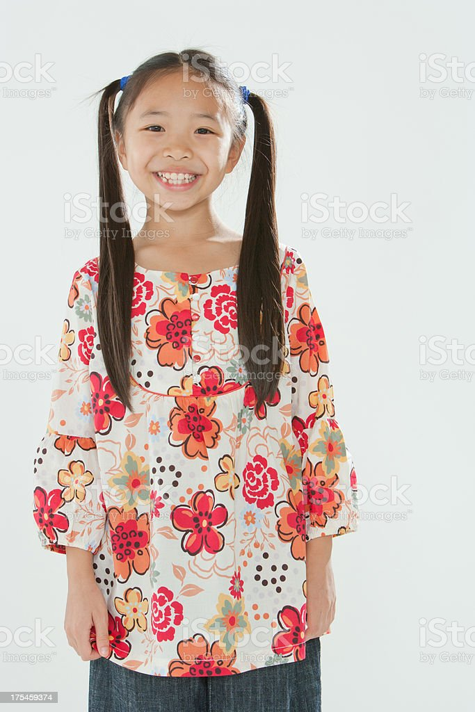 Smiling young girl standing indoors stock photo