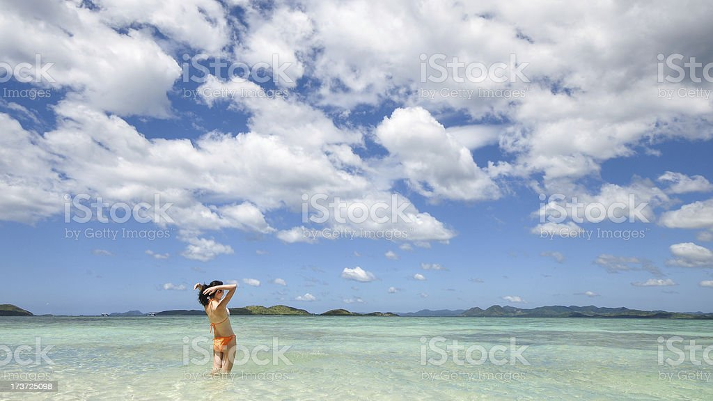 smiling young girl stands in shallow water royalty-free stock photo