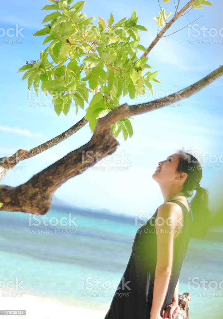 smiling young girl stands on white beach royalty-free stock photo