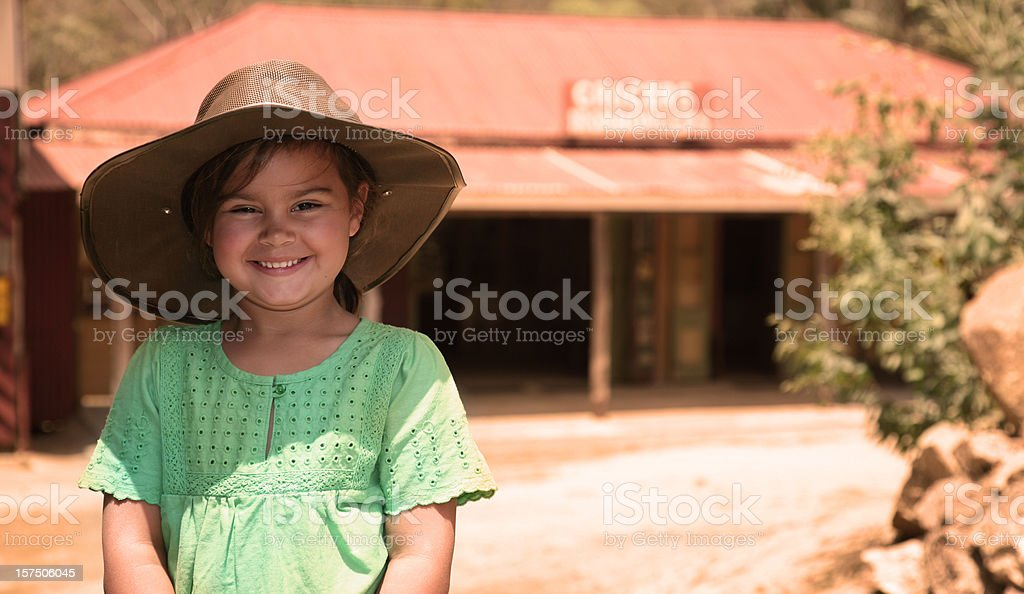 Smiling young girl wearing a hat in Australian Outback royalty-free stock photo