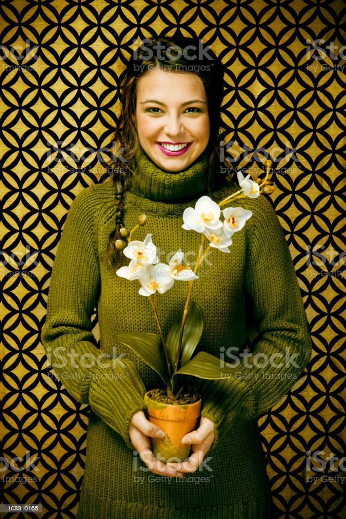 Smiling young girl with a gift for you royalty-free stock photo