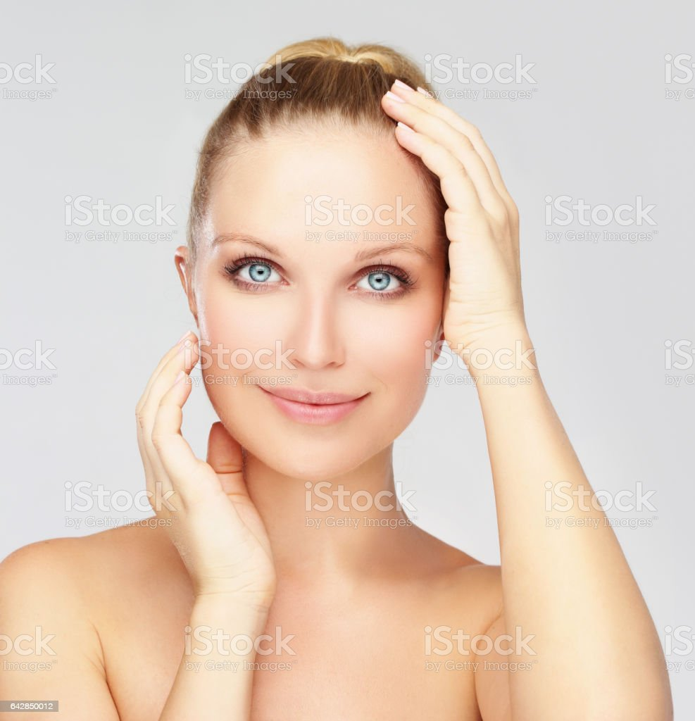 Smiling  young girl with blond hair stock photo