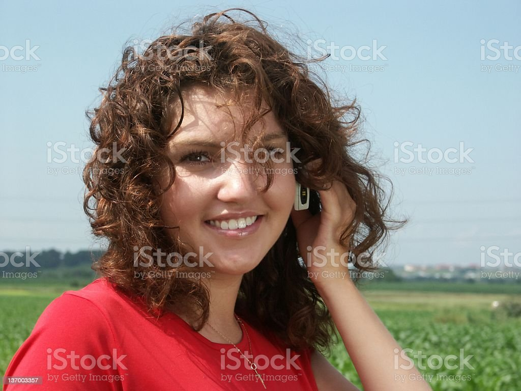 smiling young girl with cell phone royalty-free stock photo
