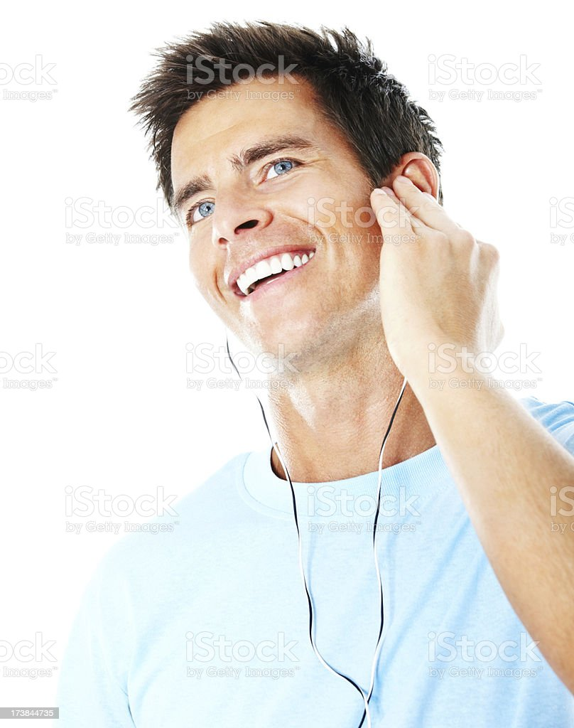 Smiling young guy listening to music royalty-free stock photo