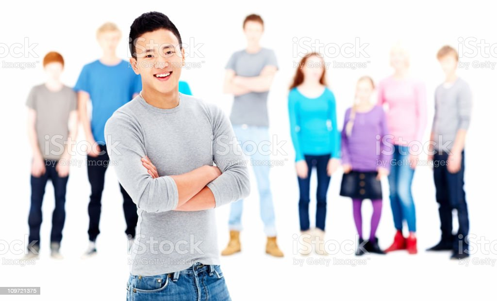Smiling young guy with friends in the background stock photo