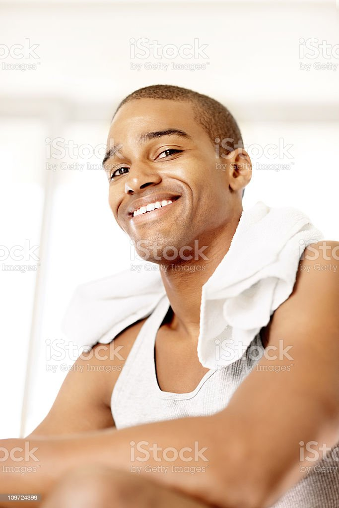 Smiling young guy with towel around neck royalty-free stock photo